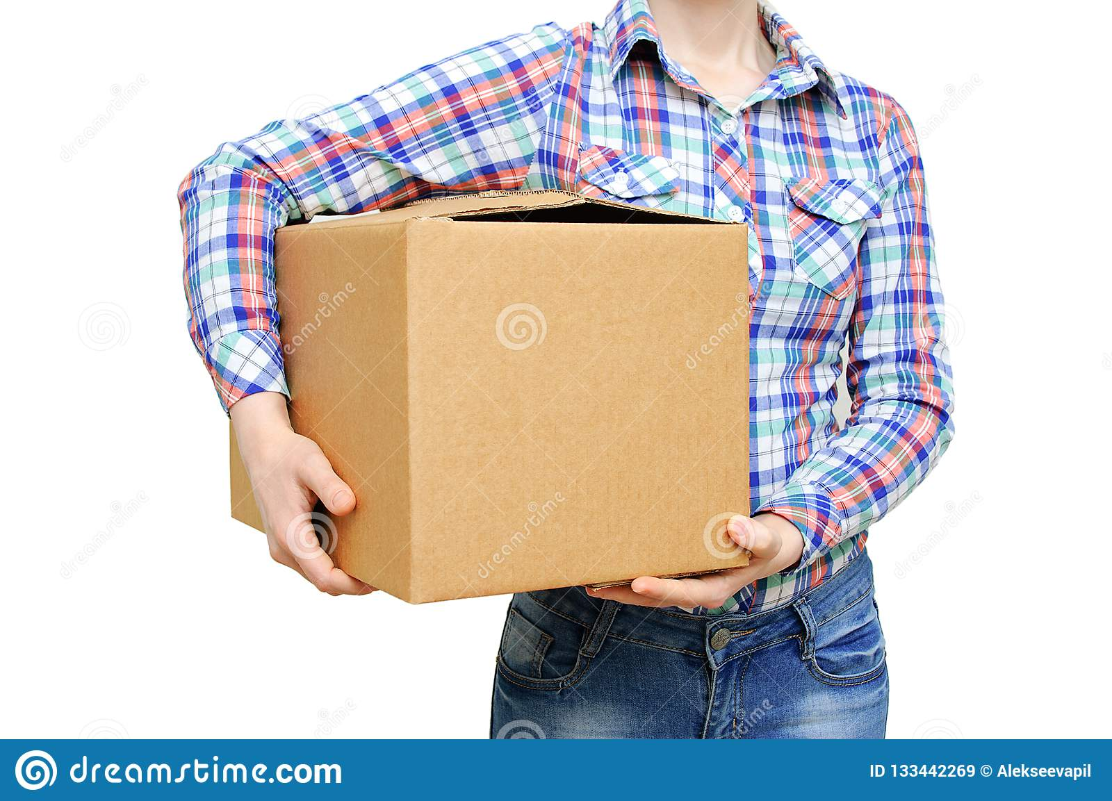 Girl in a shirt and jeans holds a large cardboard box. White isolate