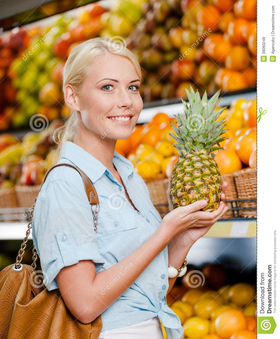 Girl At The Shop Choosing Fruits Hands Pineapple Stock ...