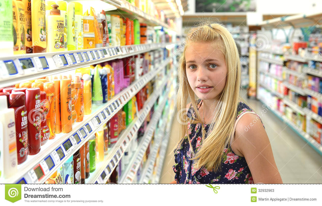 Exhibition Stand Themes : Girl shopping for beauty products stock photos image