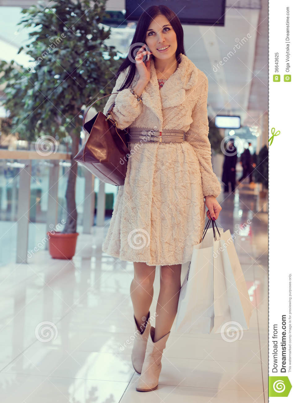 Girl in the shopping centre with shopping bags