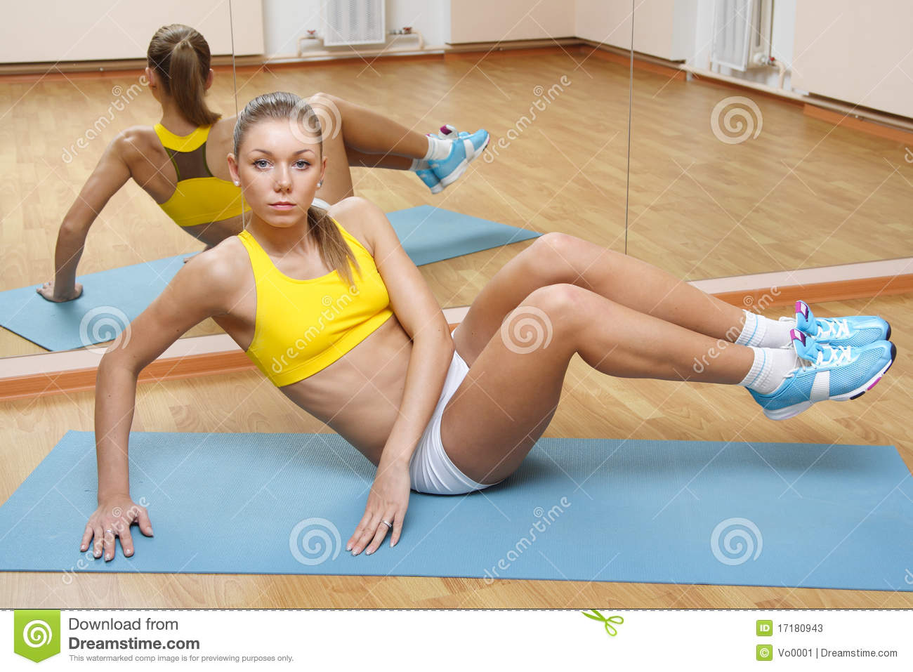 5d6543fa69d Girl In Shorts Do Exercise On Floor Mat In Gym Stock Image - Image ...