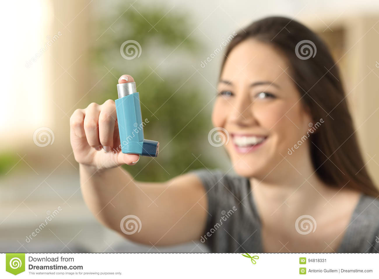 Girl showing an asthma inhaler stock image image of hand