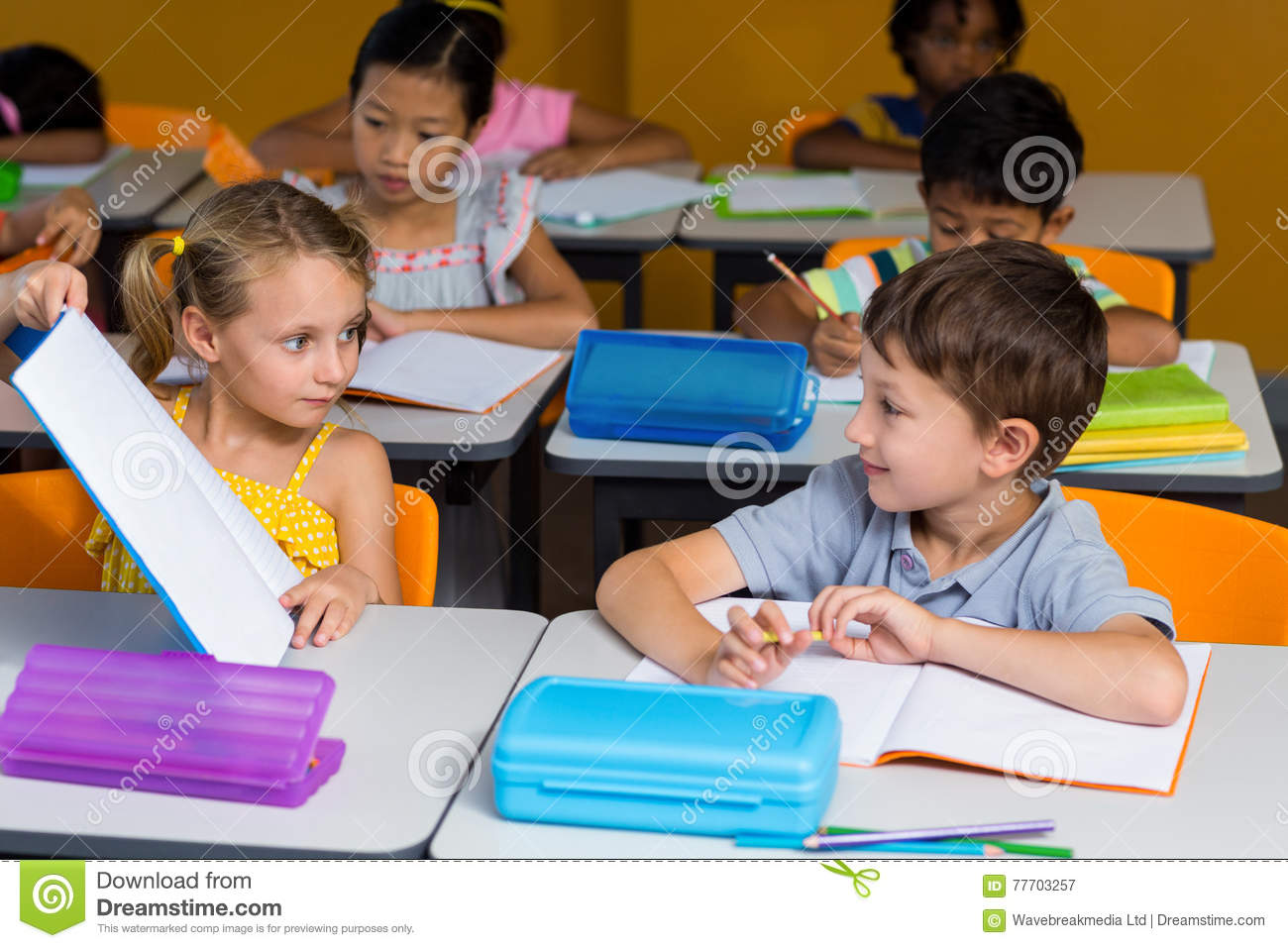 Girl Showing Book To Classmate Stock Image - Image: 77703257