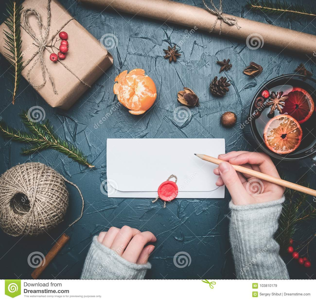 girl signs an envelope with congratulations for a new year or