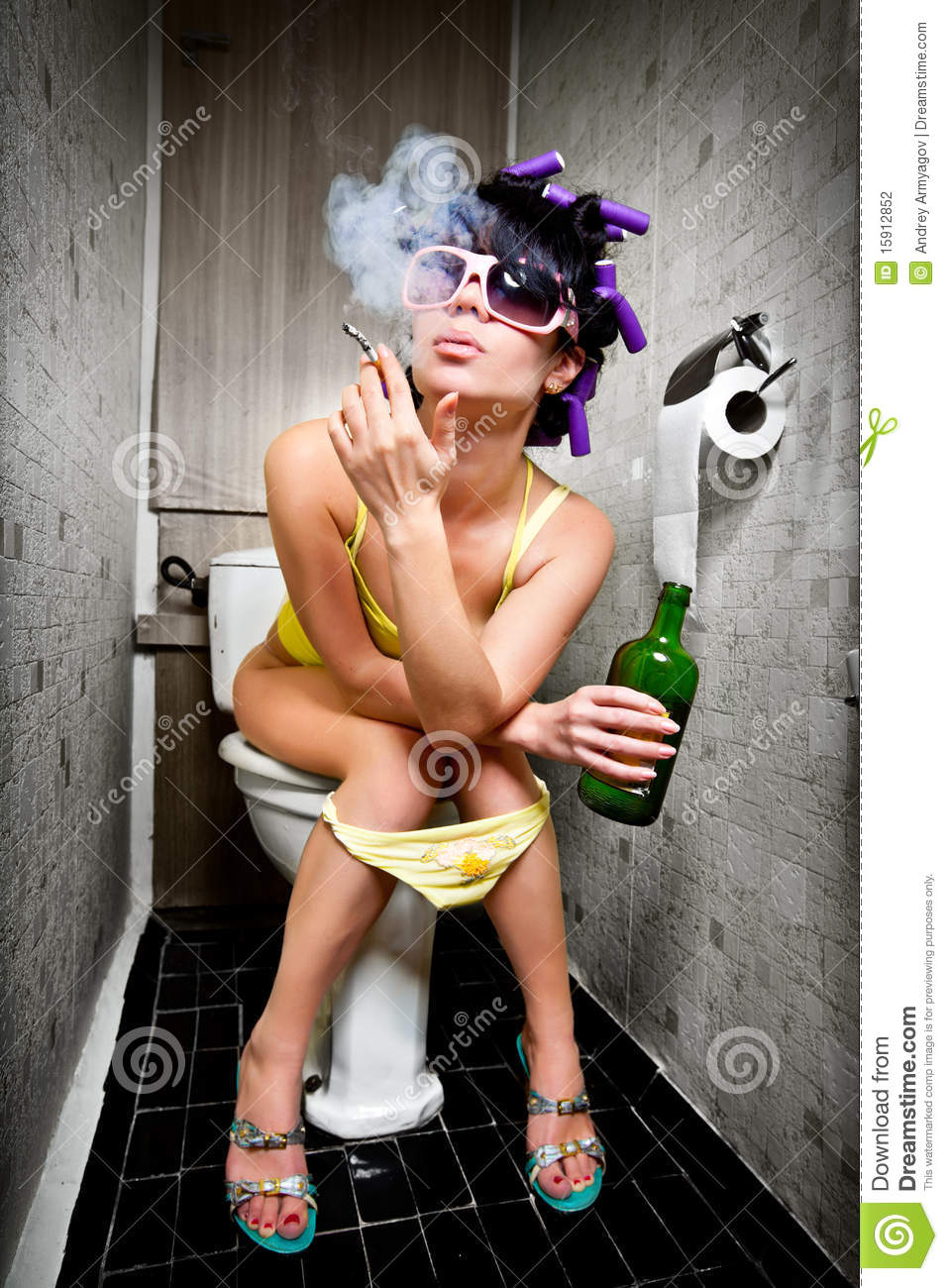 Girl sits in a toilet