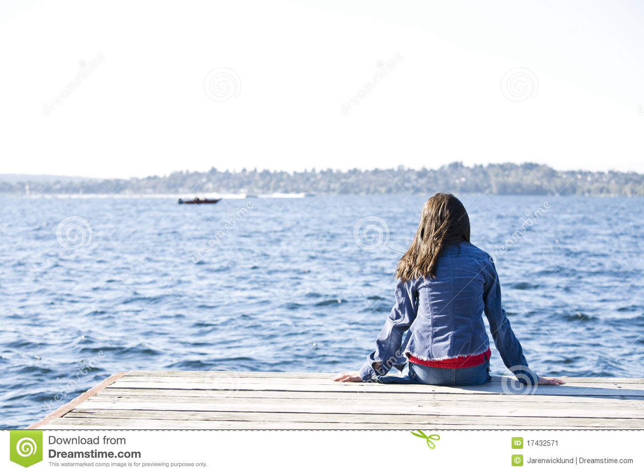 Girl Sitting Alone On Dock By Lake Stock Image - Image: 17432571