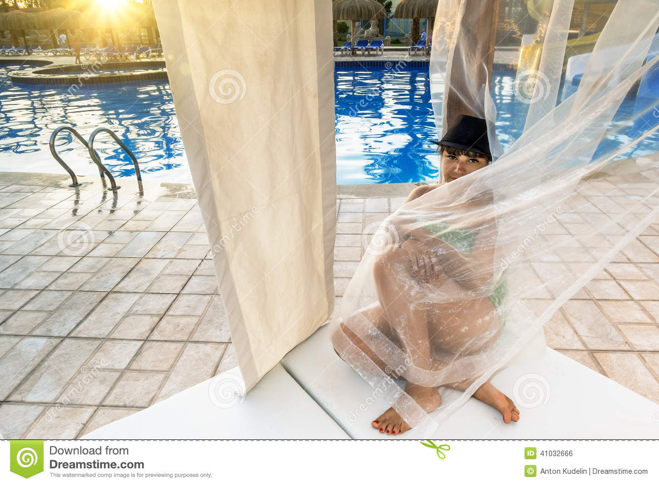 Outstanding Girl Sitting On A Beach Lounge Chair At The Pool Stock Photo Camellatalisay Diy Chair Ideas Camellatalisaycom