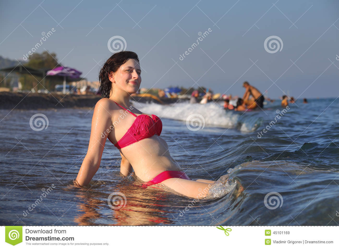 girl sitting on the beach on the surf line stock image image of