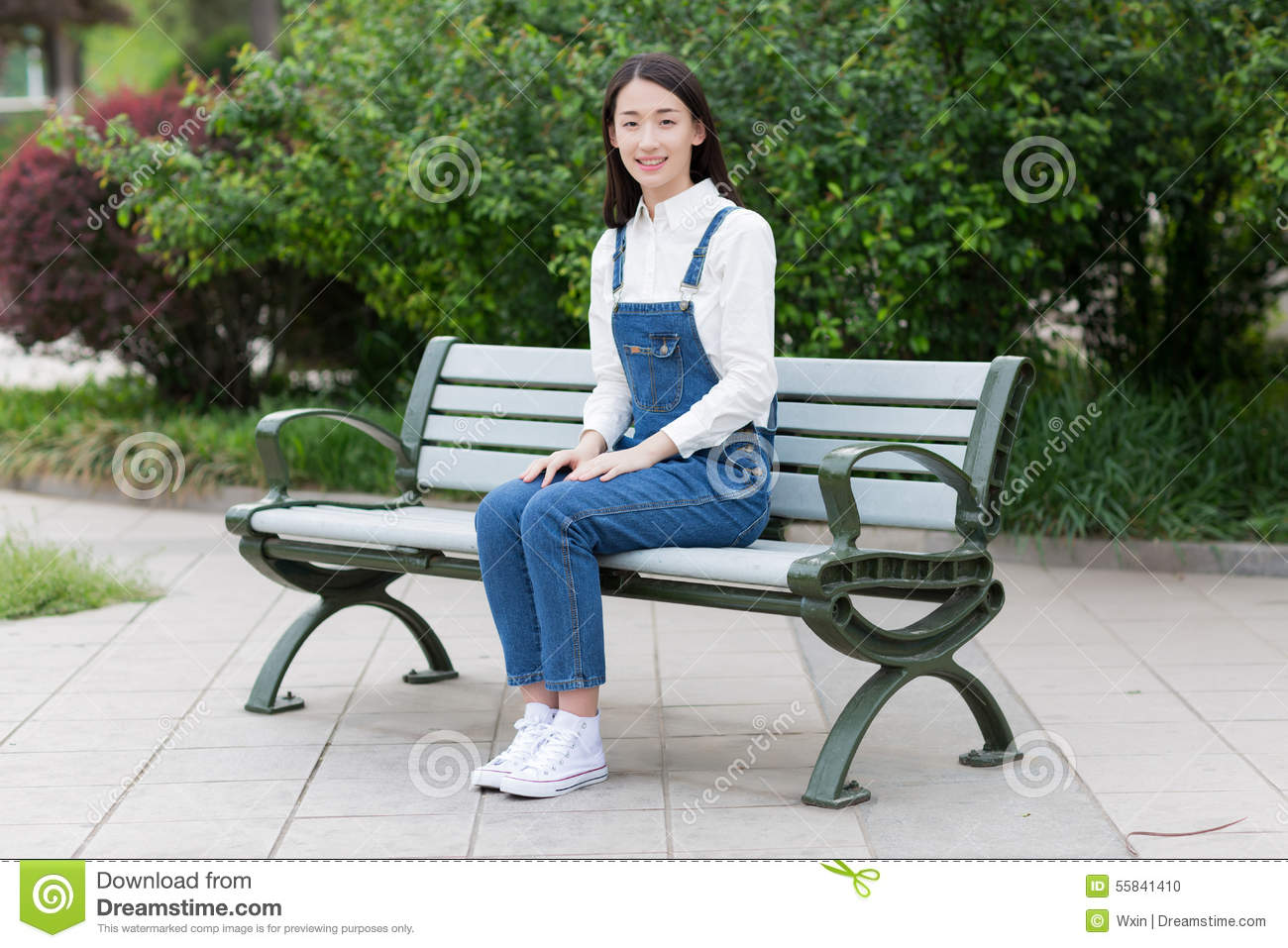Girl Sitting On A Bench Stock Photo Image 55841410