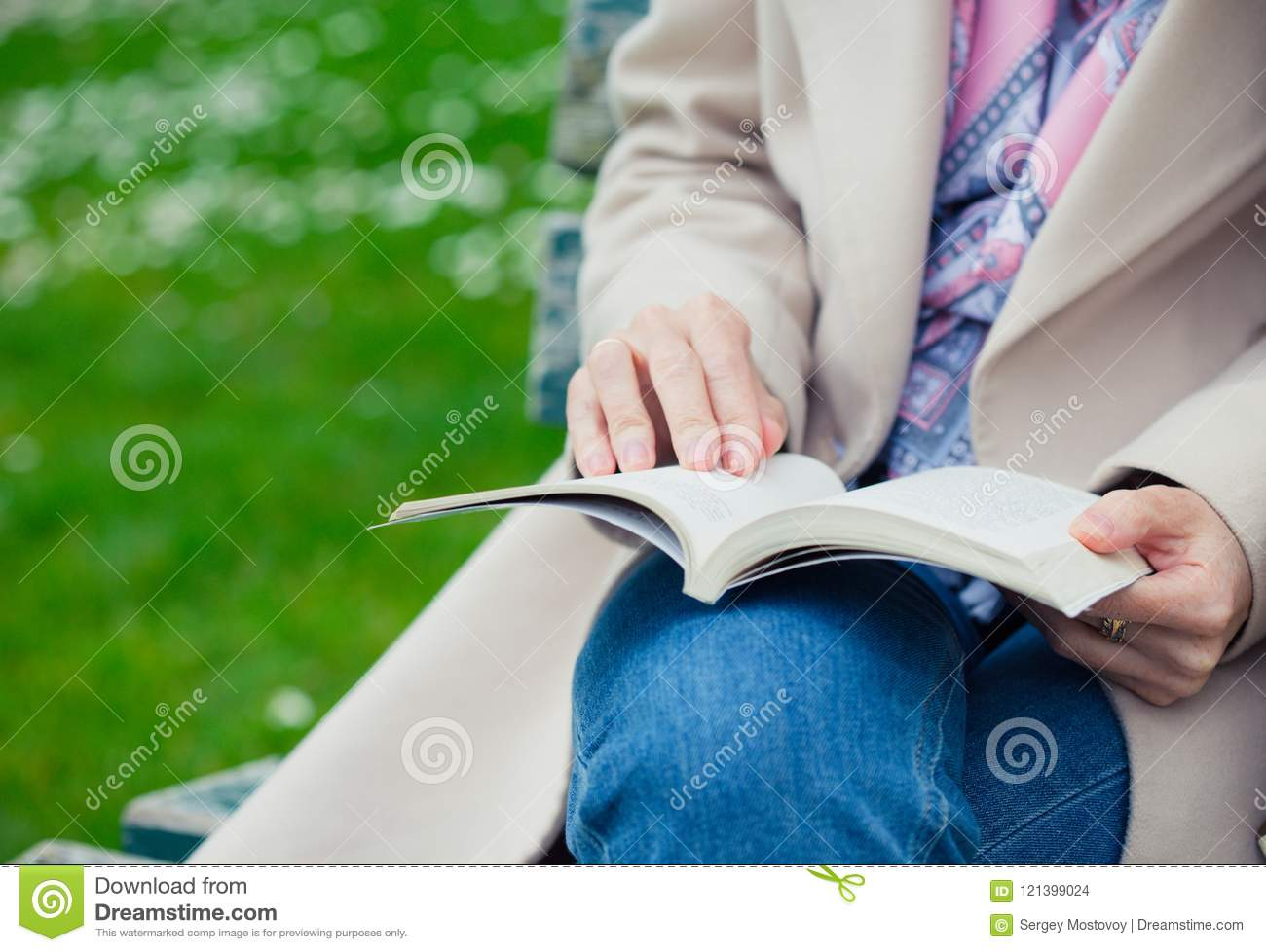 Girl reading on a bench