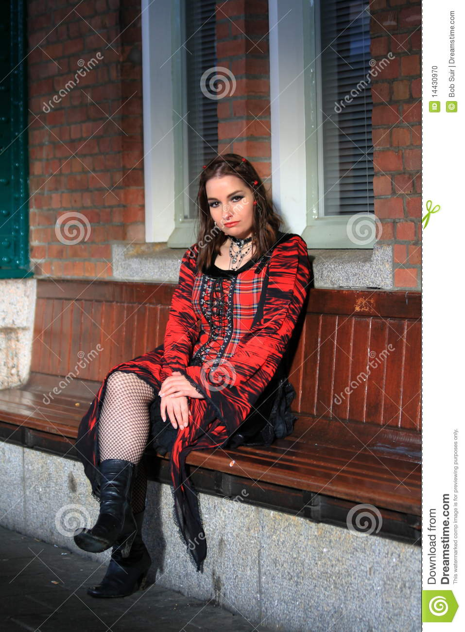Modern dress clothes for a woman - Girl Sitting On Bench Wearing Red Dress Stock Photo Image 14430970