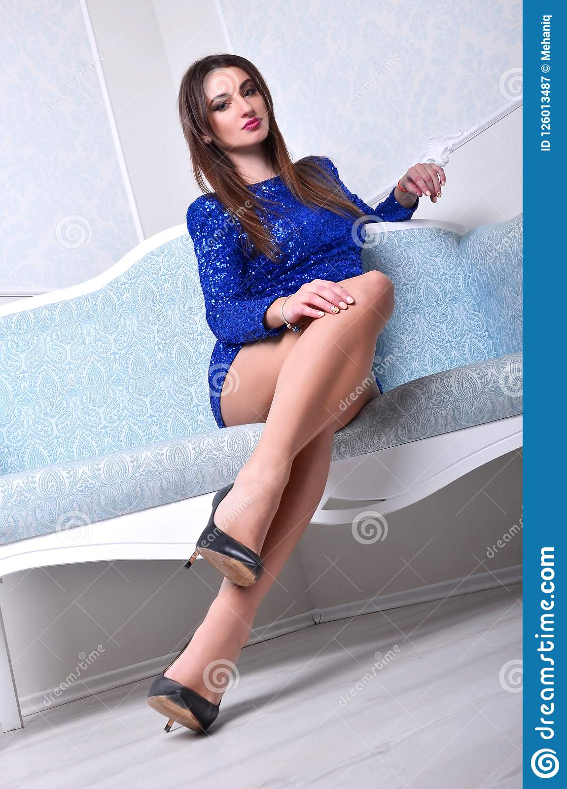 Girl sitting on the blue couch