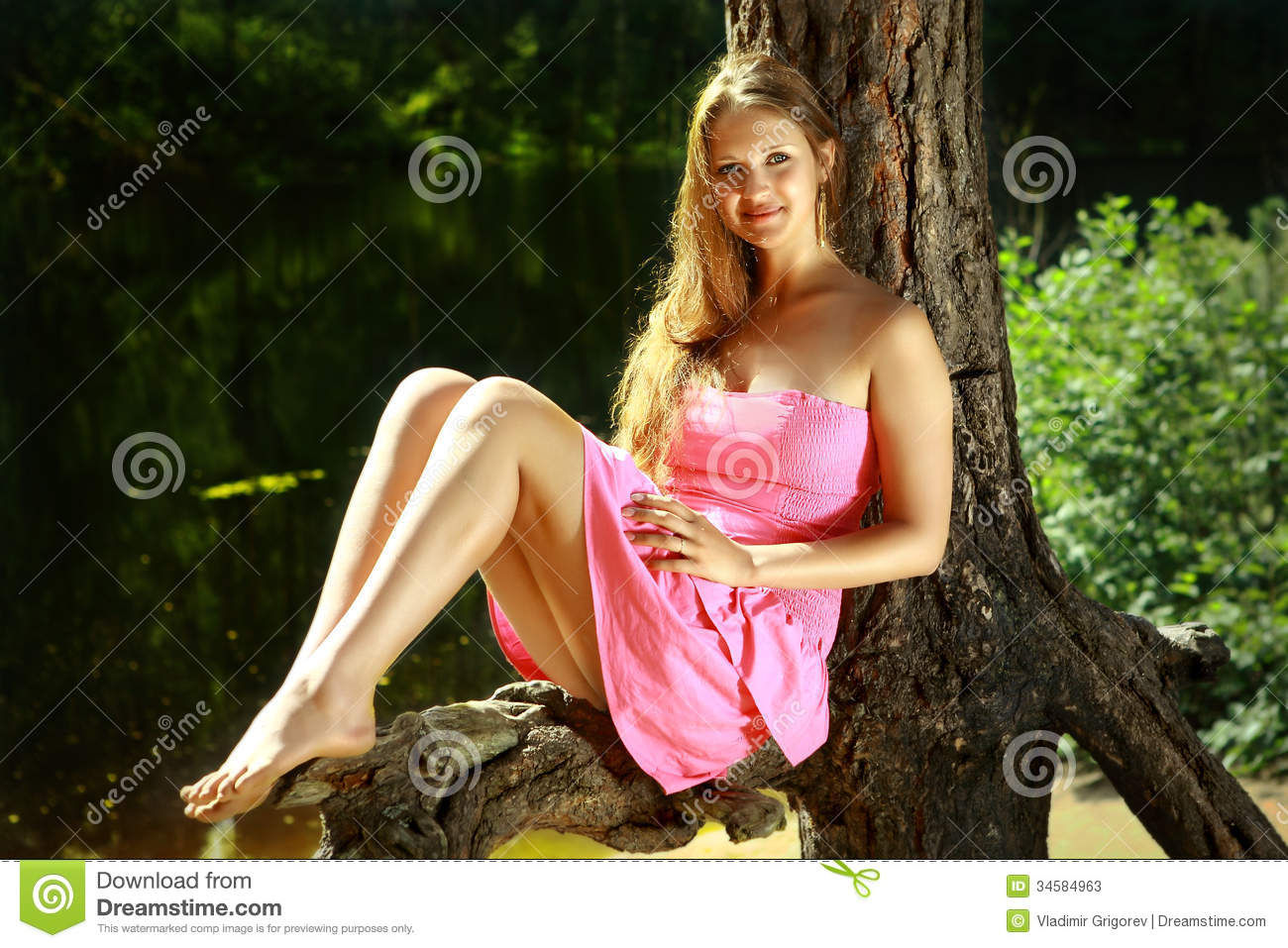 , 16 years old, in a pink dress, with long hair and bare feet