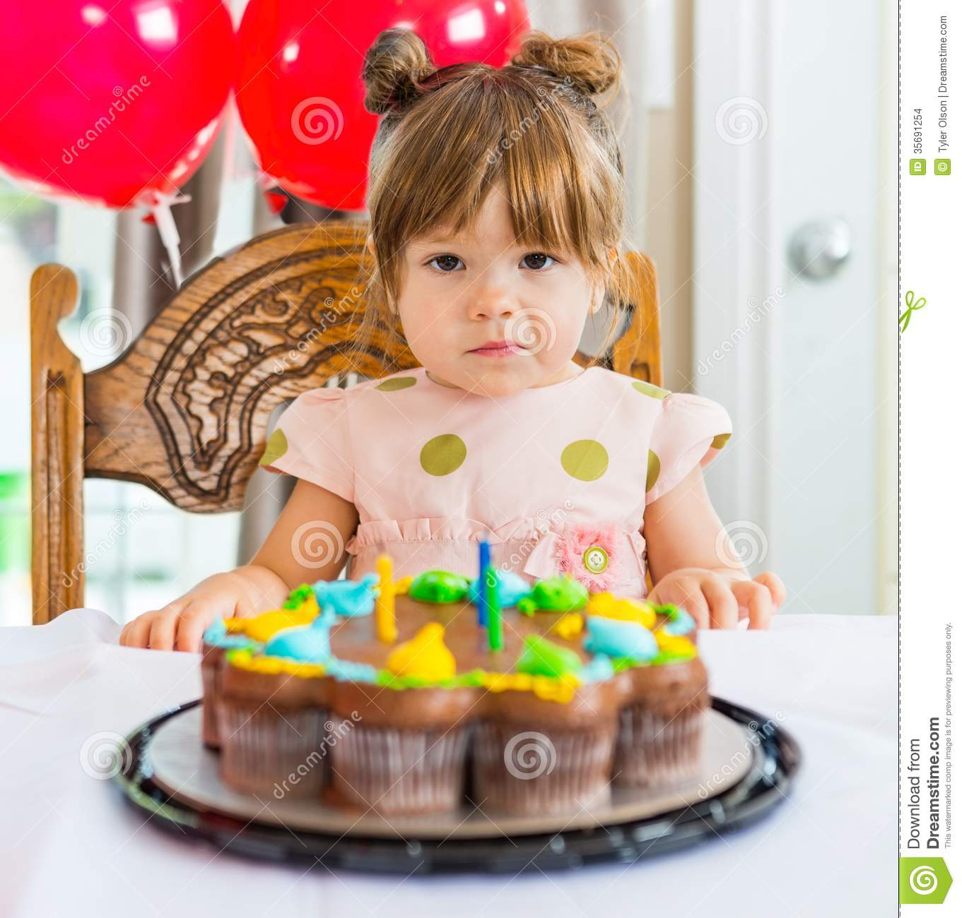 Astounding Girl Sitting In Front Of Birthday Cake Stock Photo Image Of Funny Birthday Cards Online Overcheapnameinfo