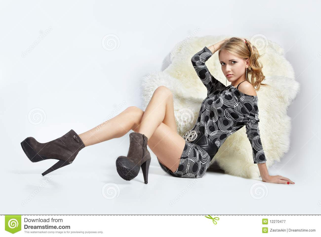 Girl Sitting Near Arm Chair Royalty Free Stock Photography