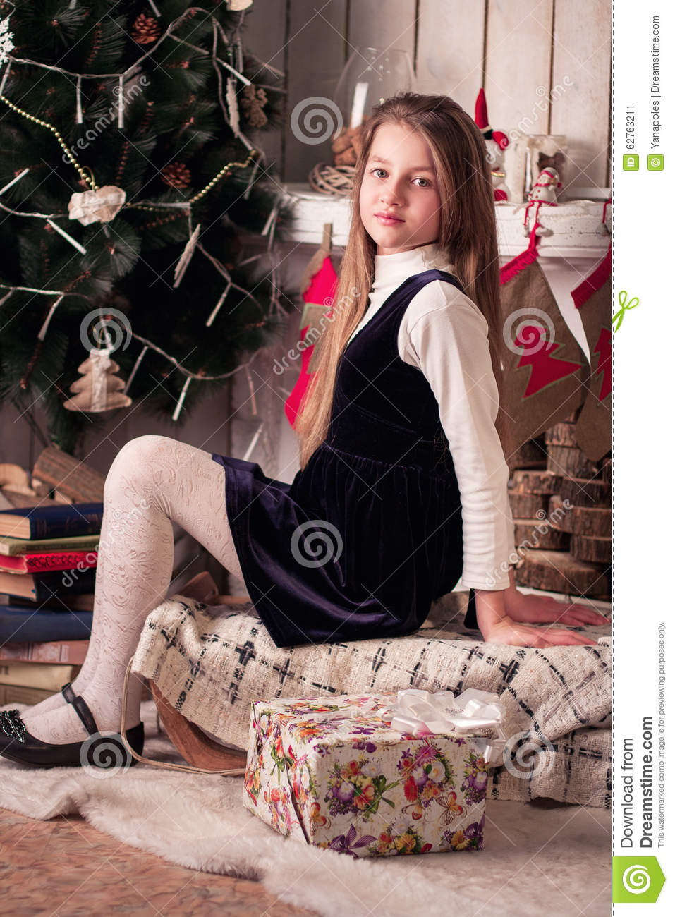 Girl Sitting Near The New Year Decorations Stock Image ...