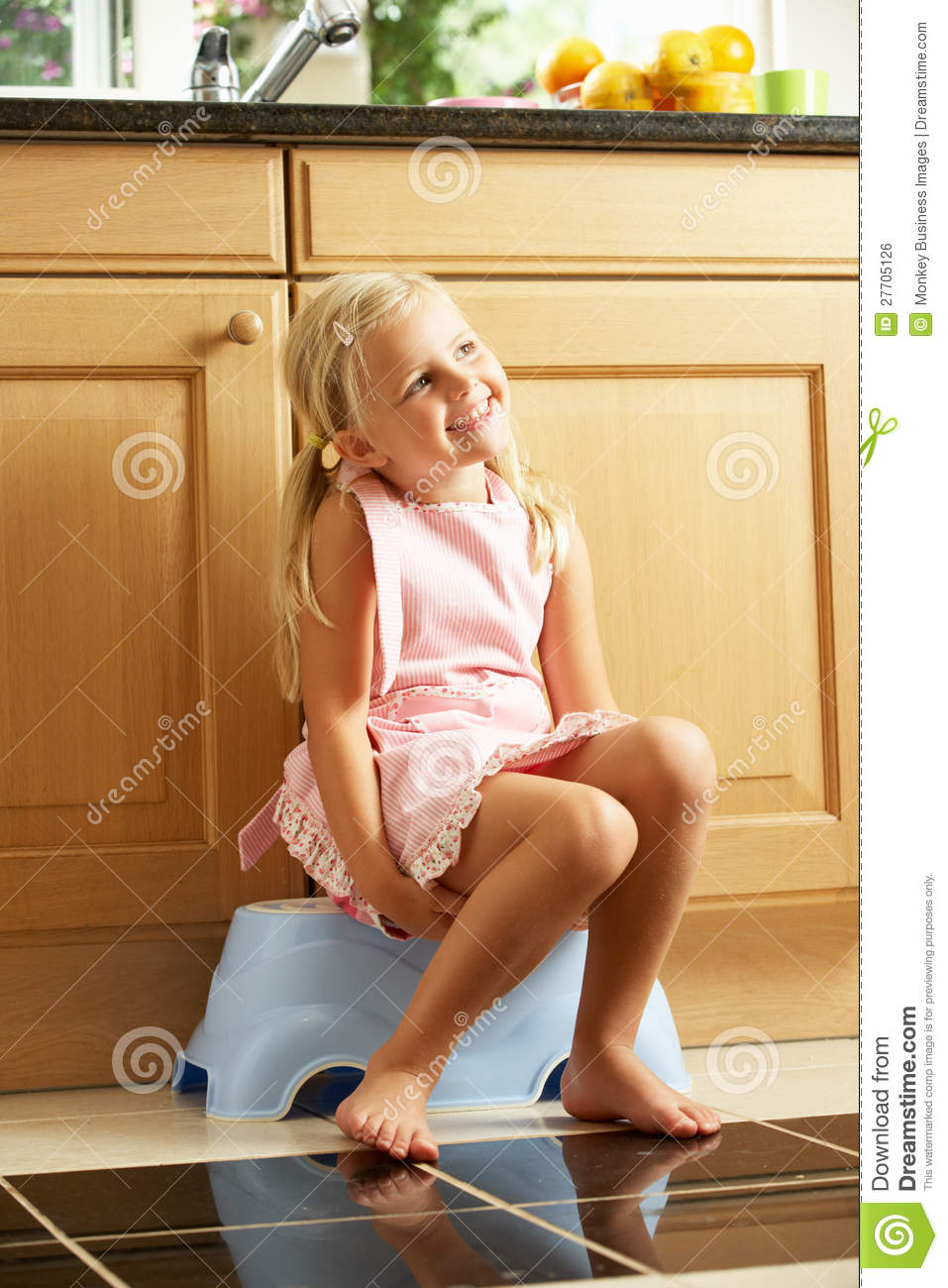 Girl Sitting On Plastic Step In Kitchen Royalty Free Stock