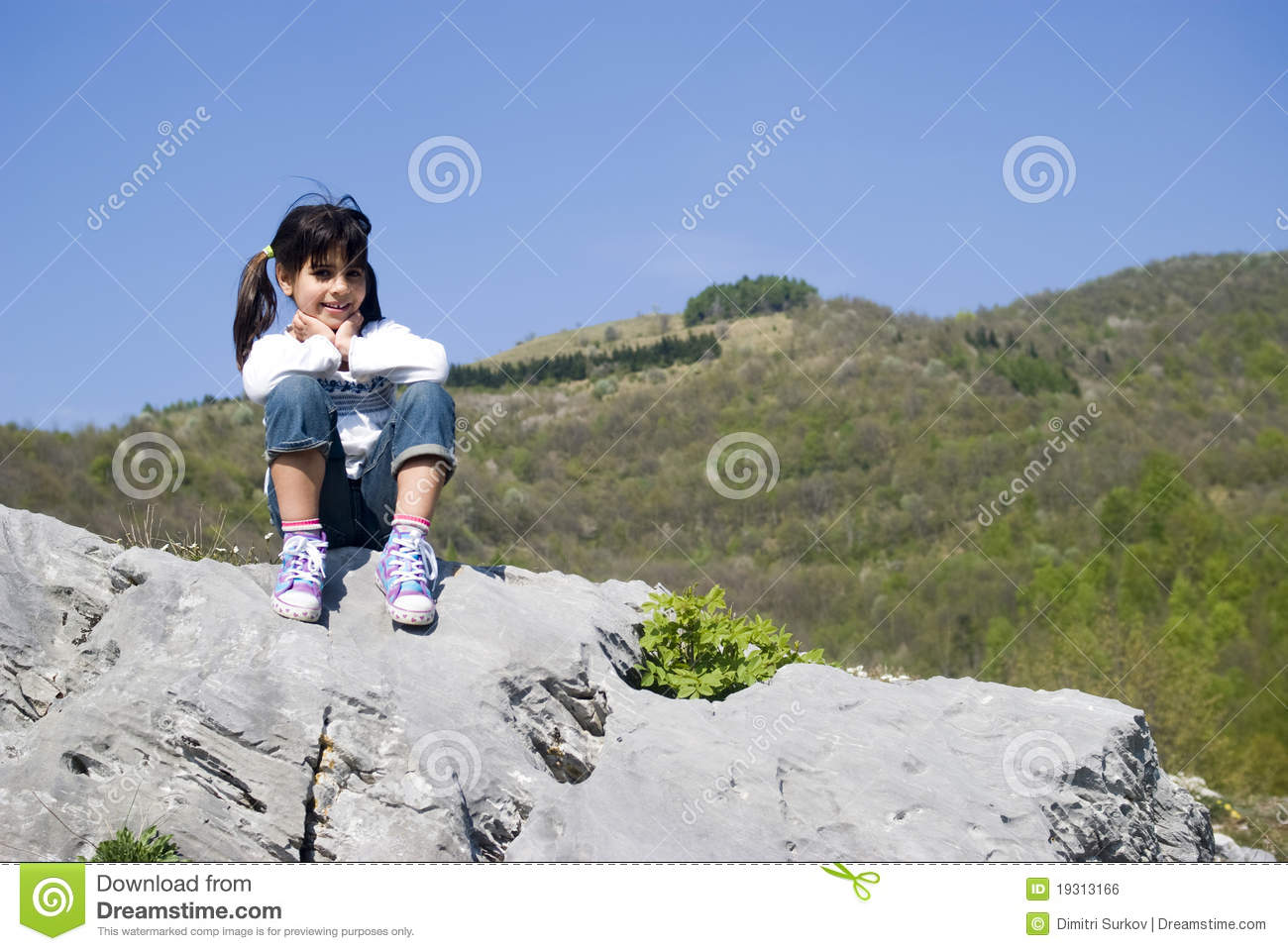 Attended the Girl sitting on rock butt