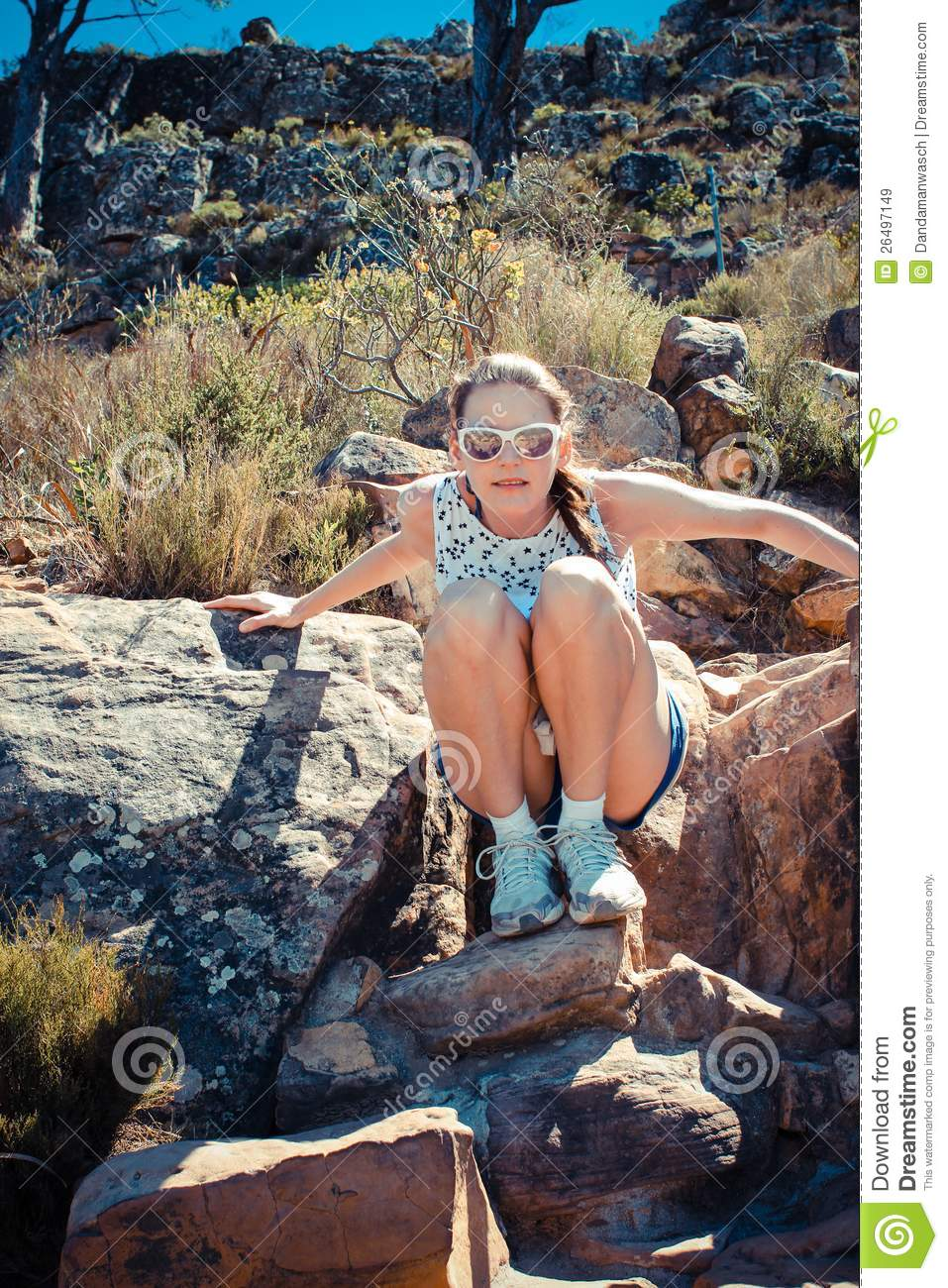 Really wanted girl sitting on rock very