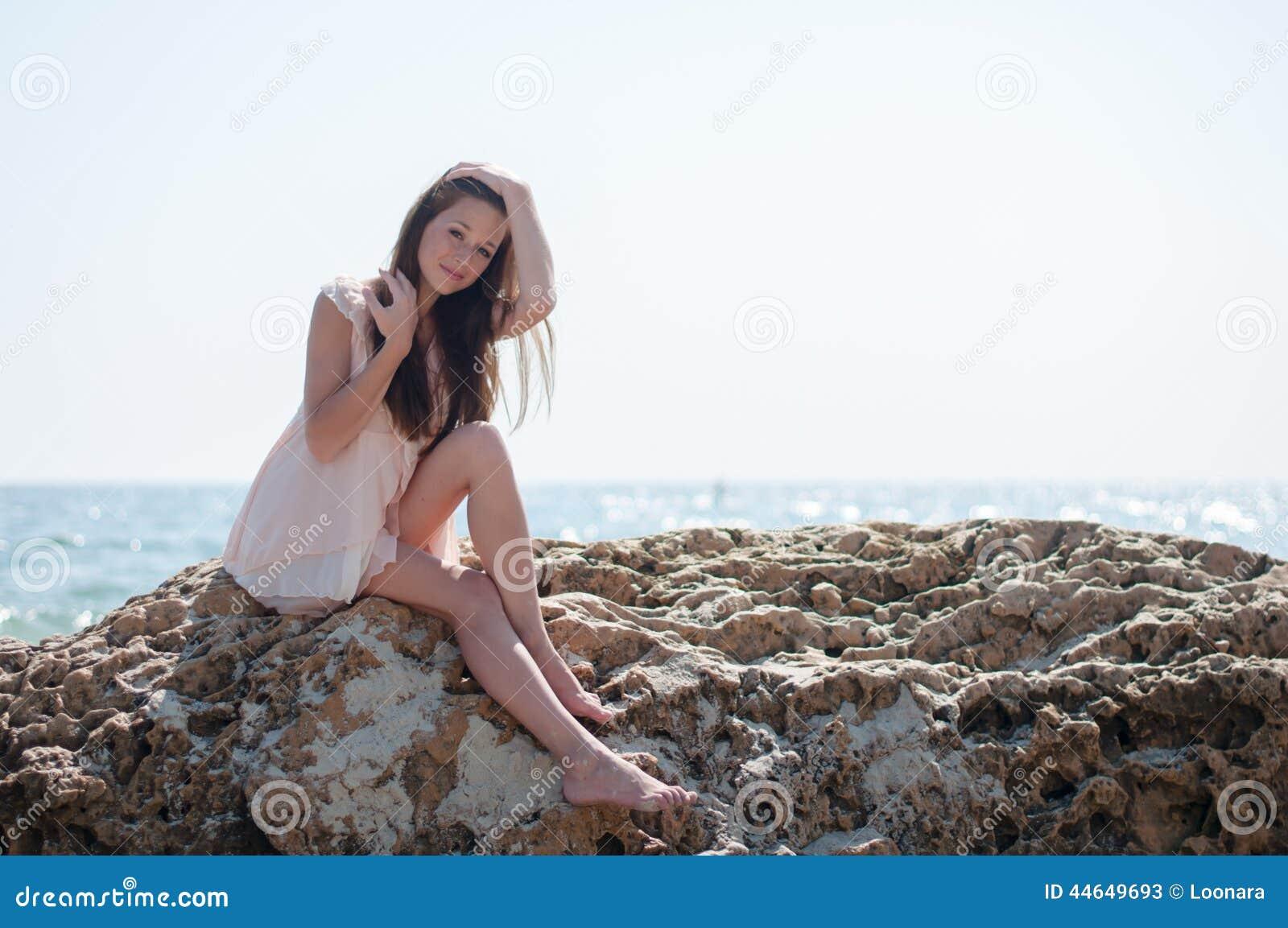 Deal Girl sitting on rock Ukrainian