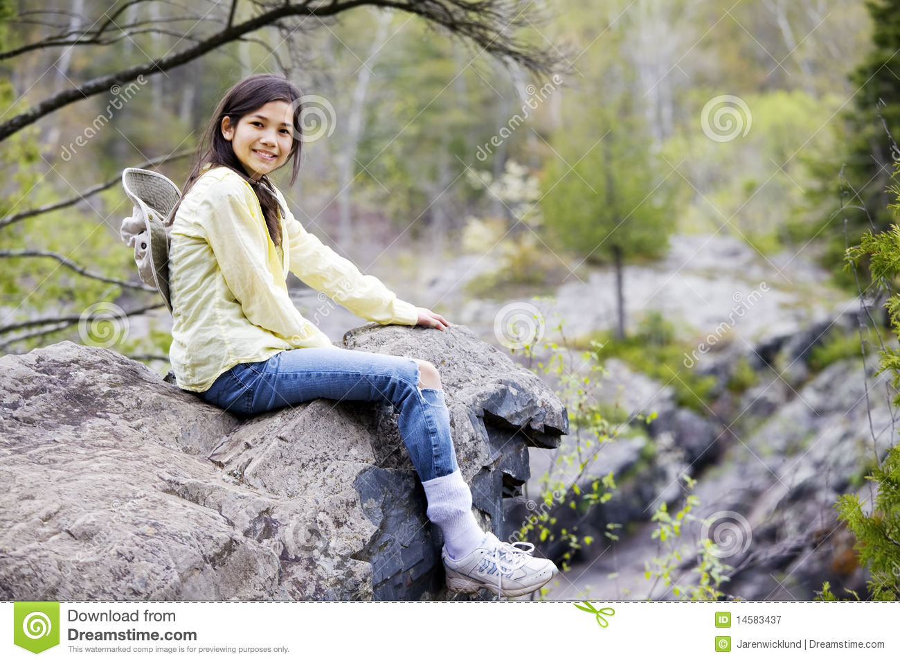Damn girl sitting on rock