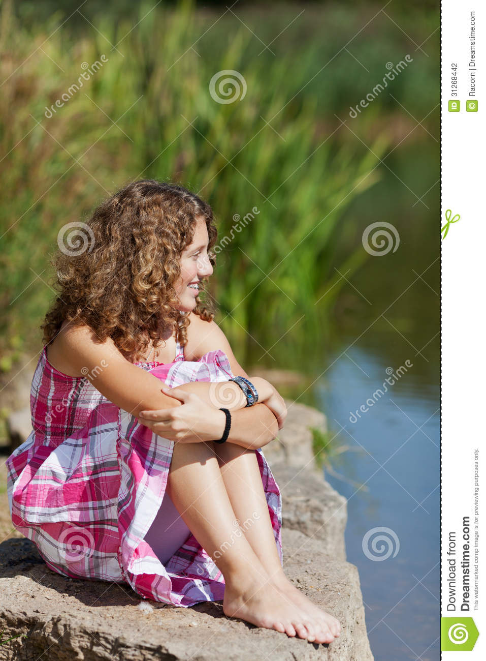 Girl sitting on rock want