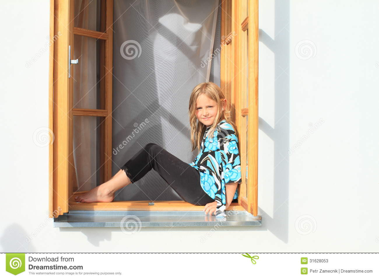 girl sitting in the window stock photos image 31628053