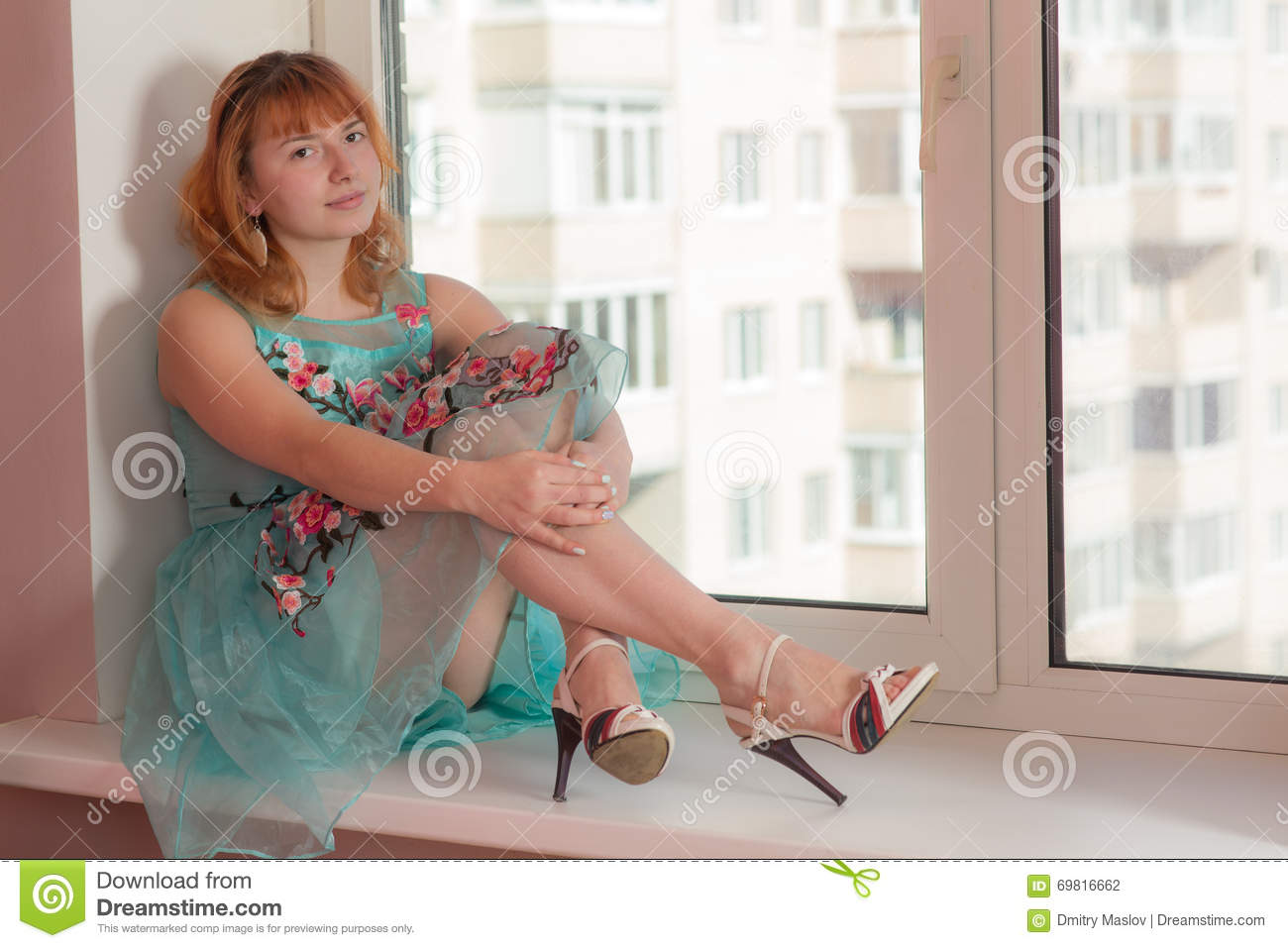 Girl Sitting On A Window Sill Stock Photo Image 69816662