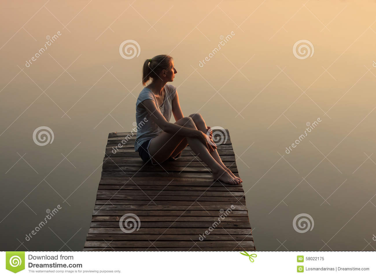 Download Girl Sitting On A Wooden Pier Or Jetty On The Lake At Sunset Stock Image - Image of relaxing, calm: 58022175