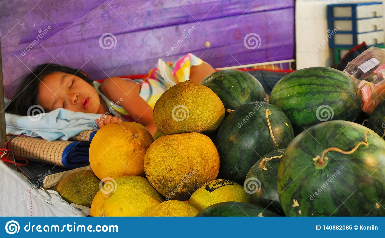 A girl sleeping on a market. Thailand.