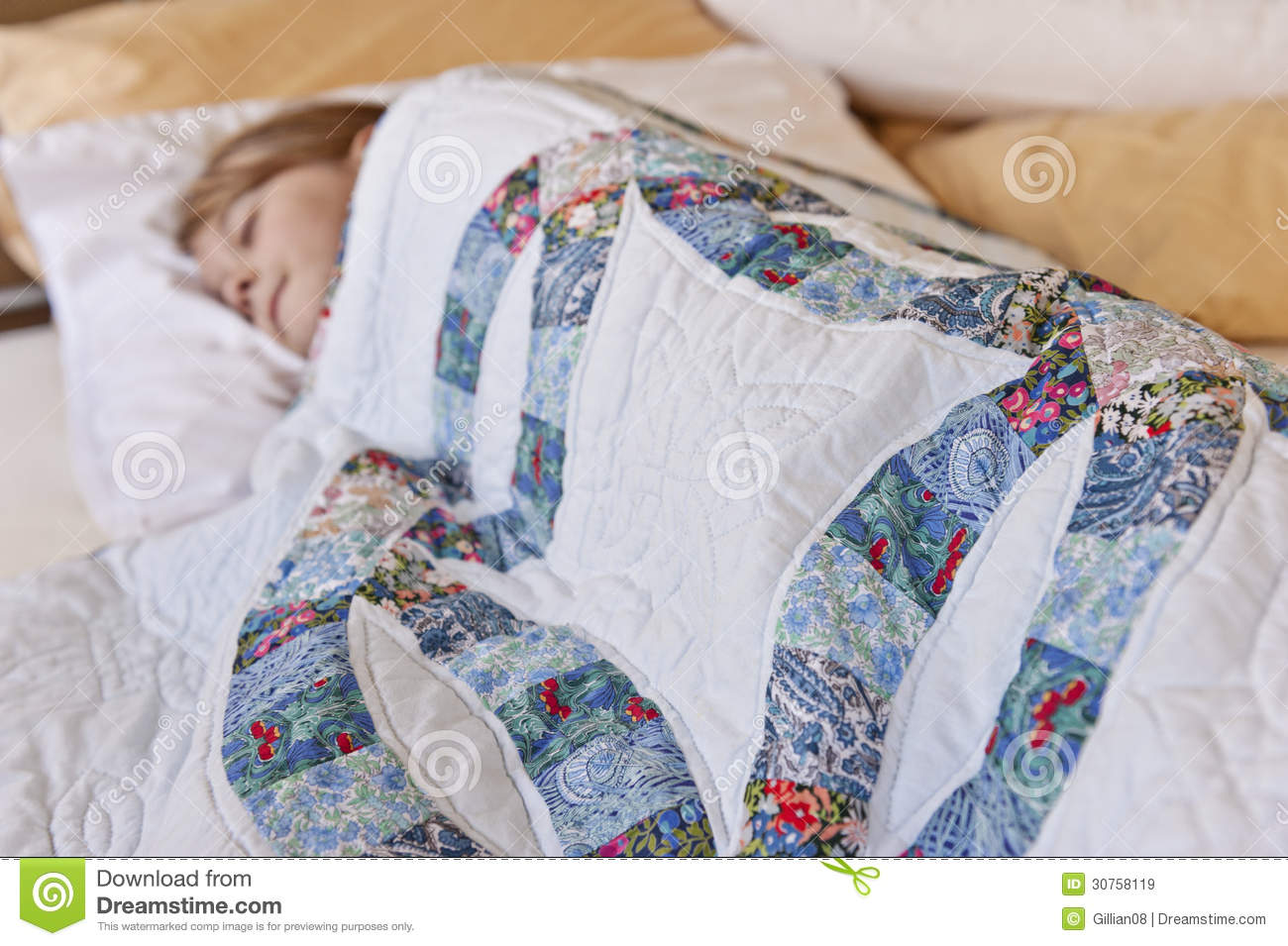 Girl Sleeping Under Quilt Royalty Free Stock Images