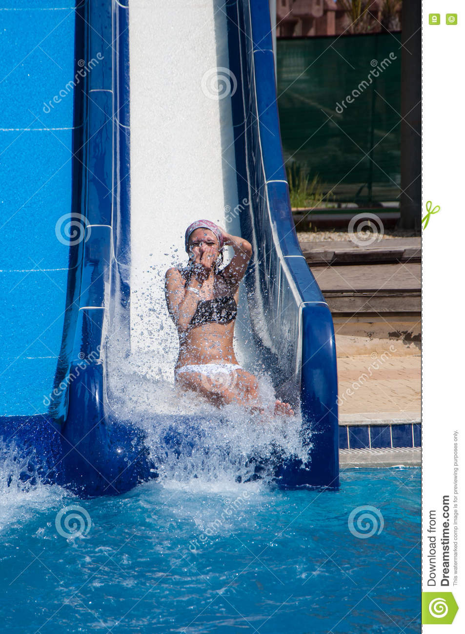 Girl sliding down water slides