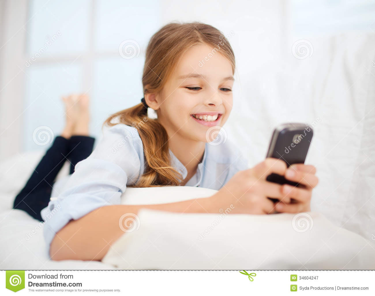 Girl With Smartphone At Home Royalty Free Stock