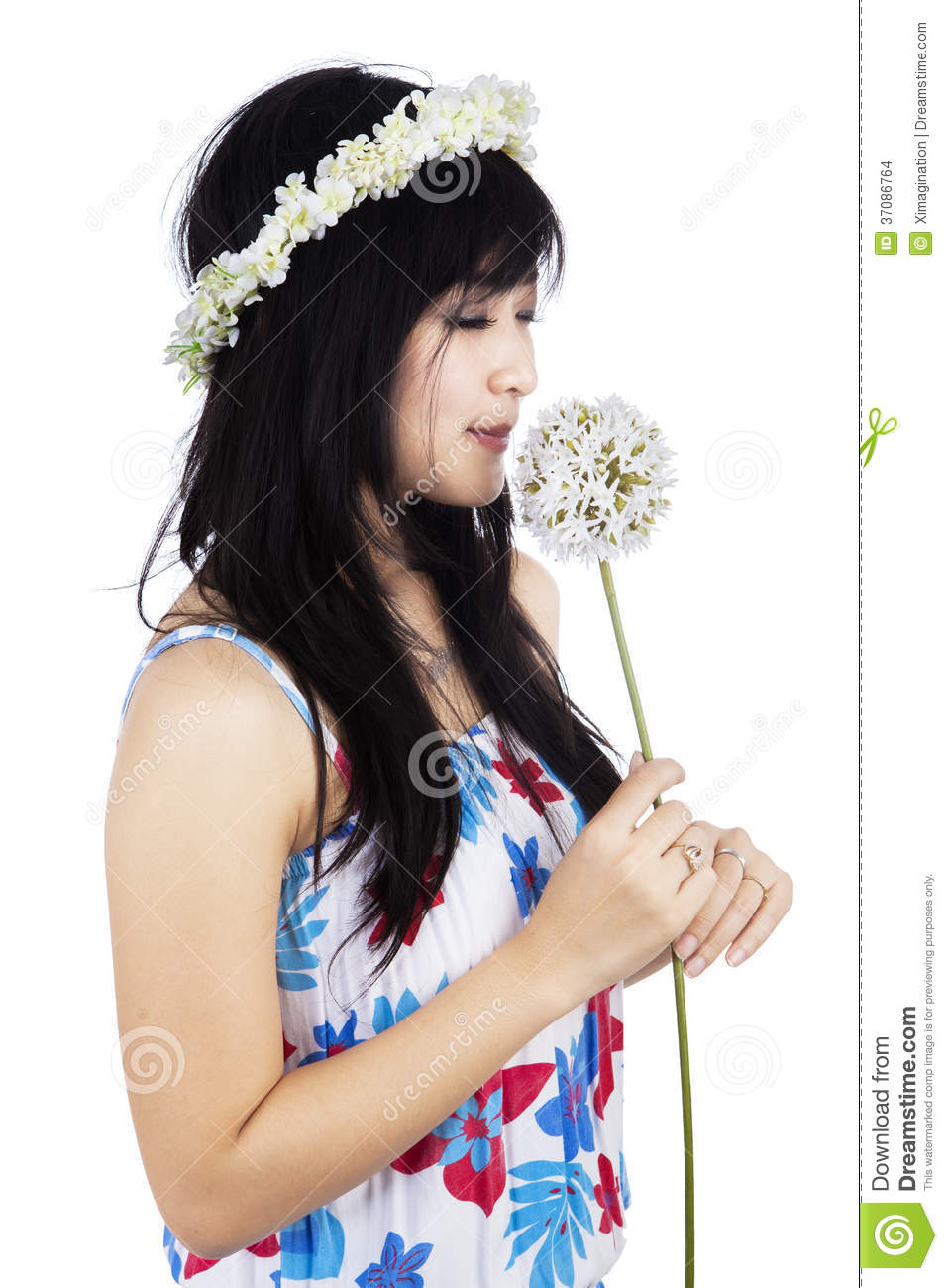 Girl is smelling a flower