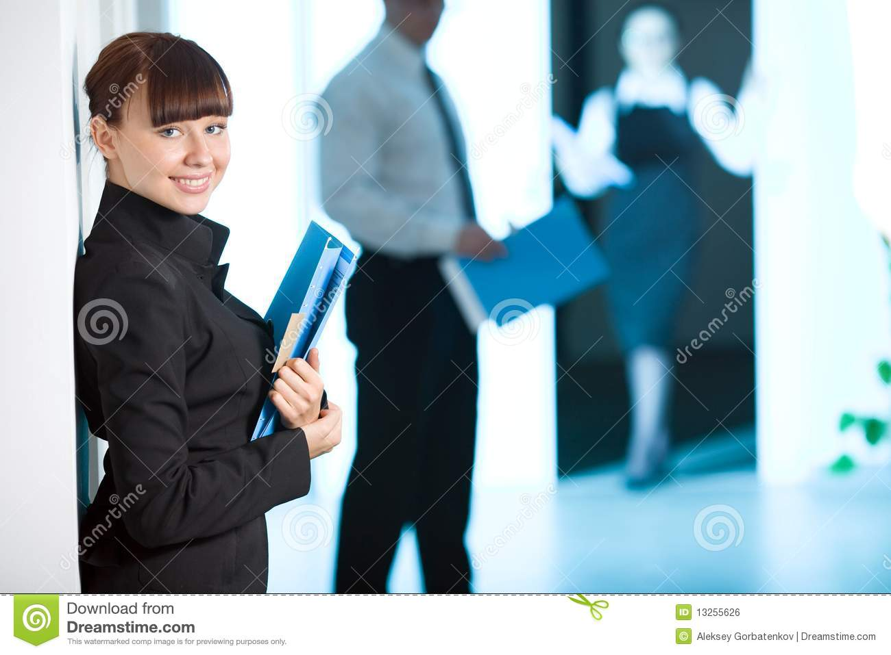 Girl with smile with blue folder
