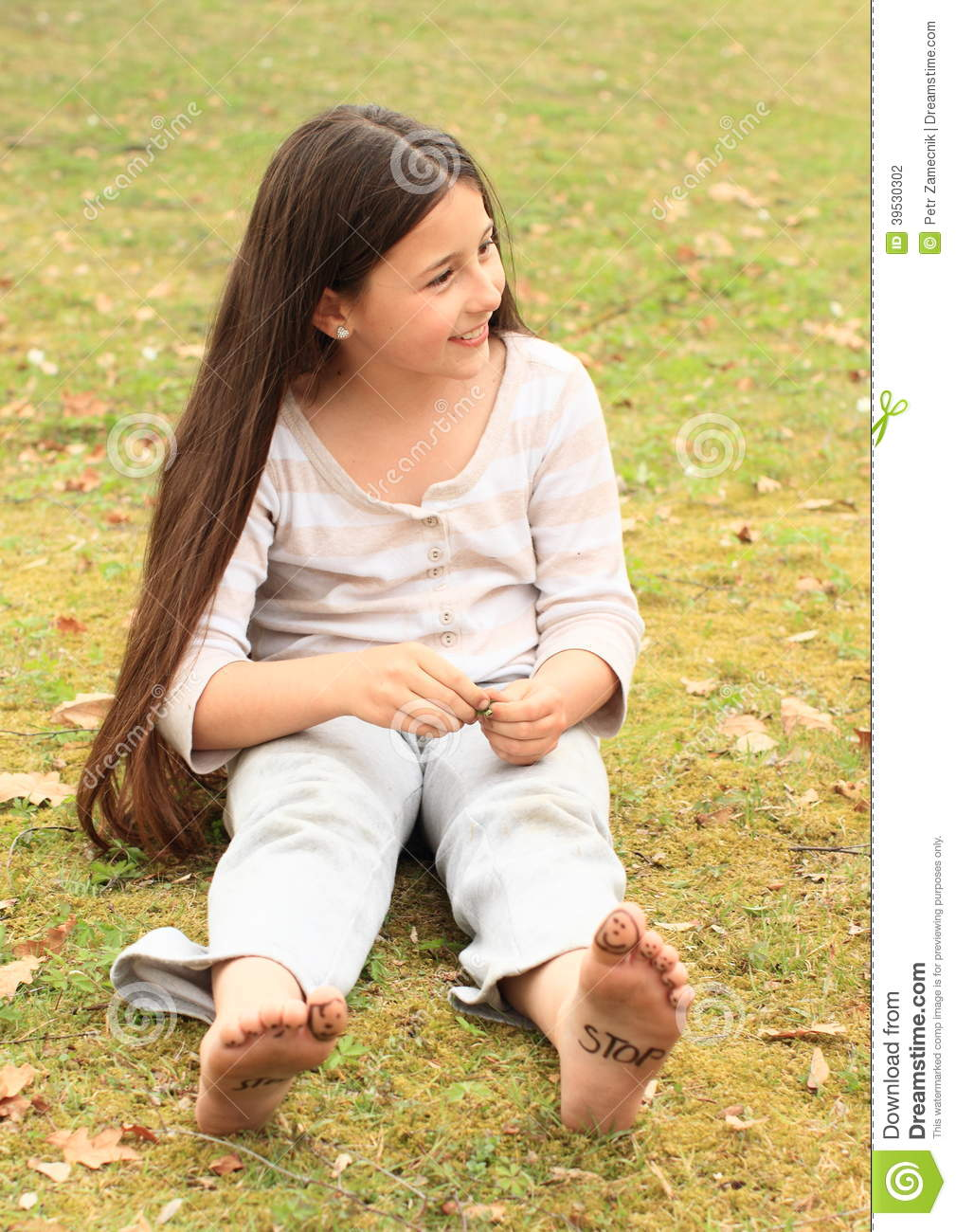 girl with smileys on toes and sign stop on soles stock photo - image