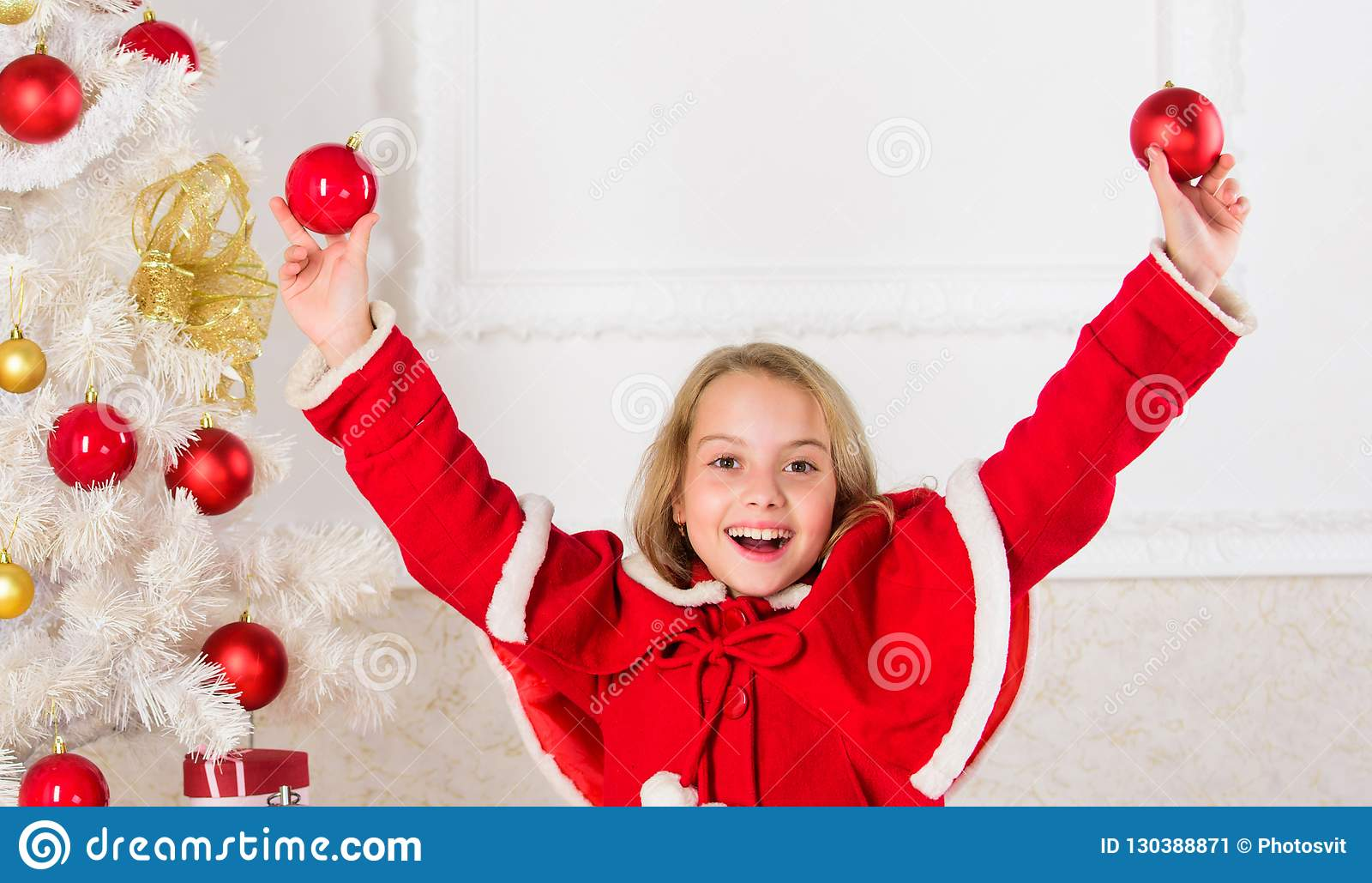 Girl smiling face hold balls ornaments white interior background. Let kid decorate christmas tree. Favorite part