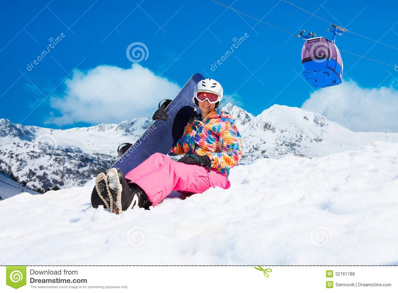 4f7eacfee655 Happy woman in pink sit in snow with snowboard with cable car and mountains  on blue sky background
