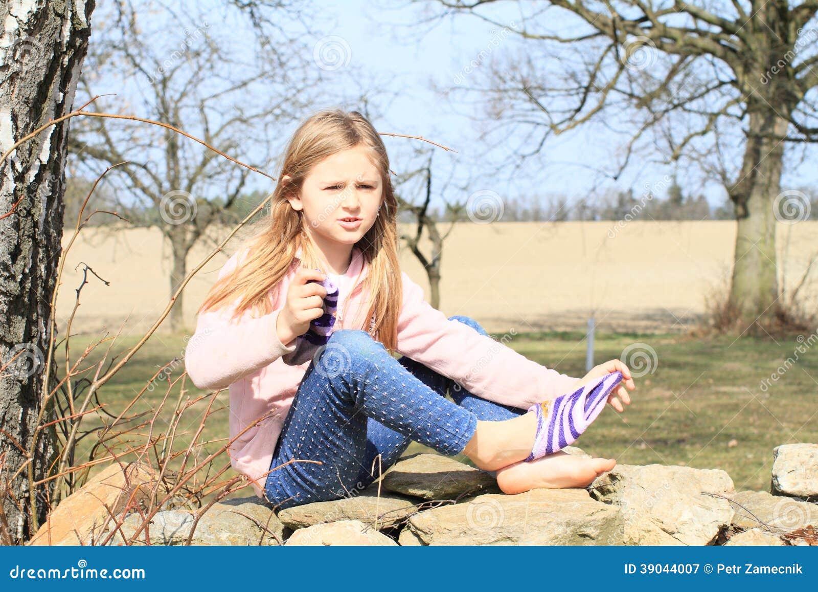 girls taking socks off