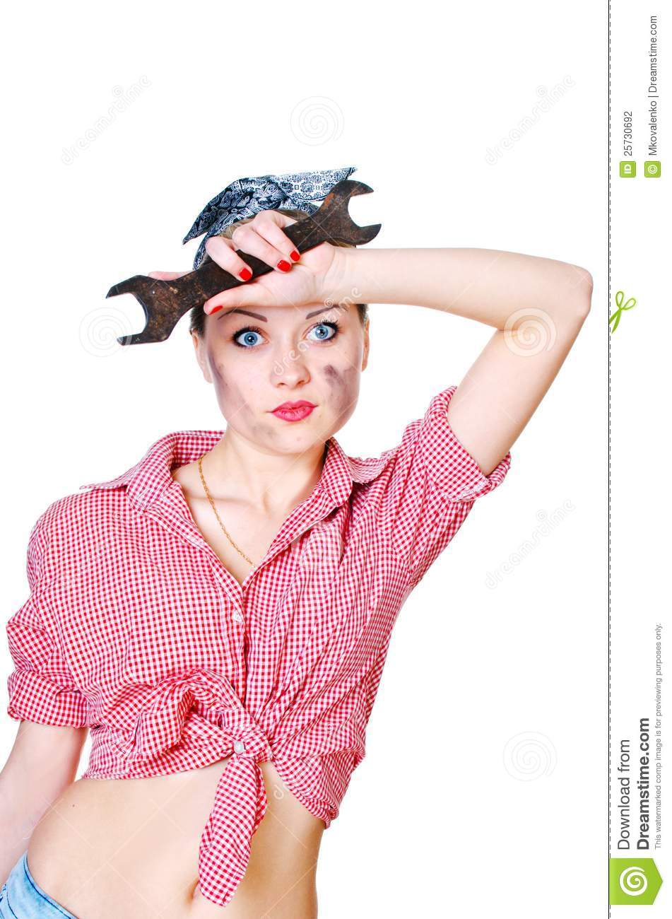 Girl with spanner wiping her brow
