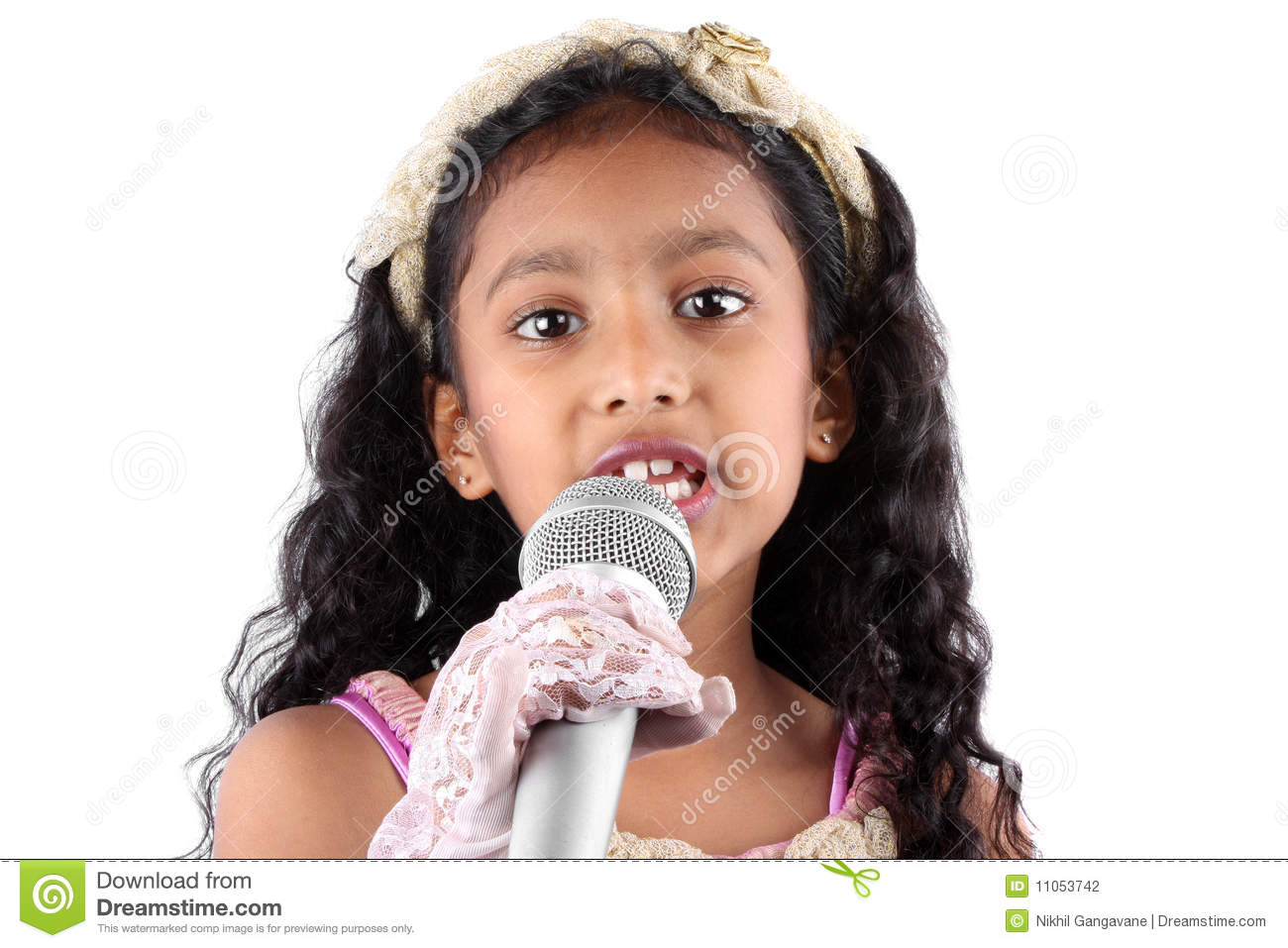 ... Indian girl making a speech, holding a mic on white studio background