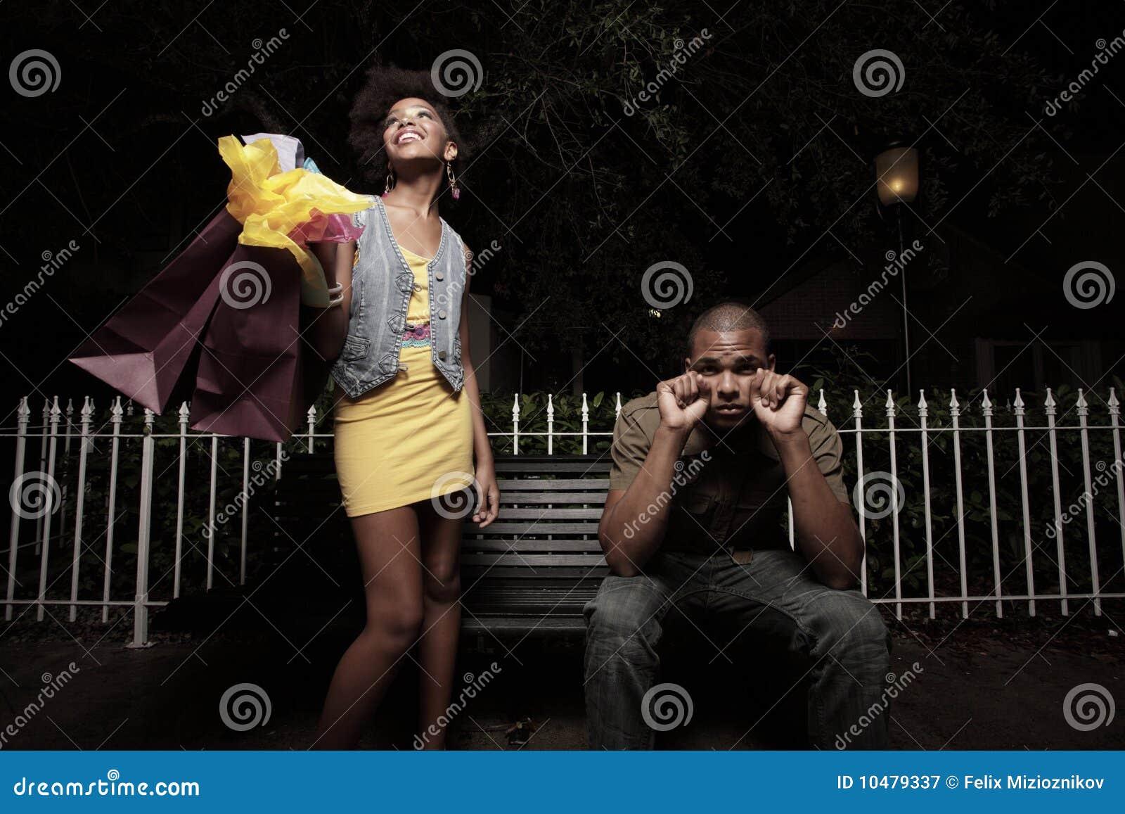 Download Girl spending boy's money stock image. Image of nighttime - 10479337