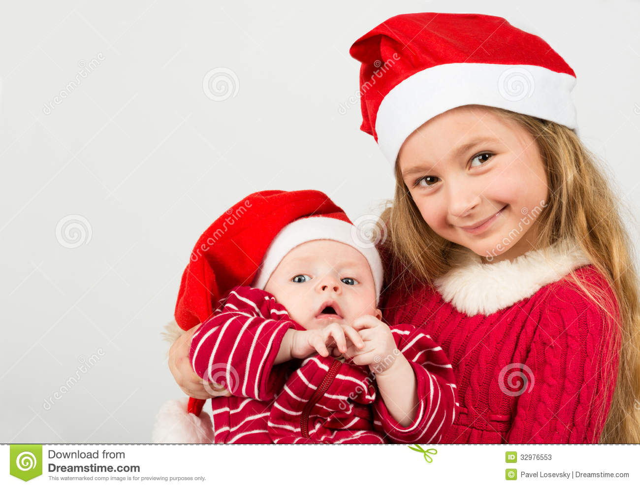bb9425de36d5 Girl Stand In Santa Claus Hats And Holding Baby Boy Stock Image ...