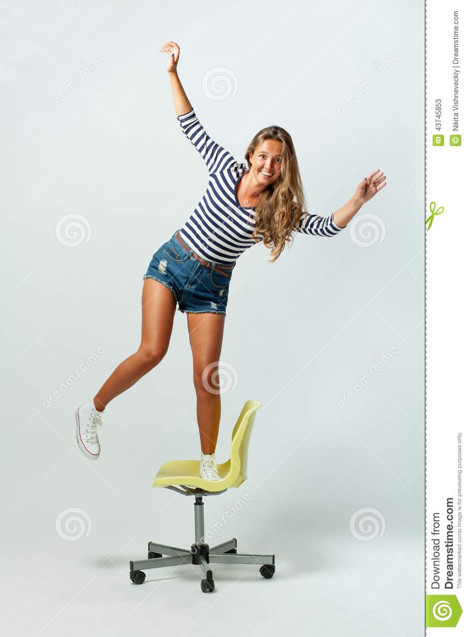 Girl Standing On A Chair Balancing Stock Photo - Image ...