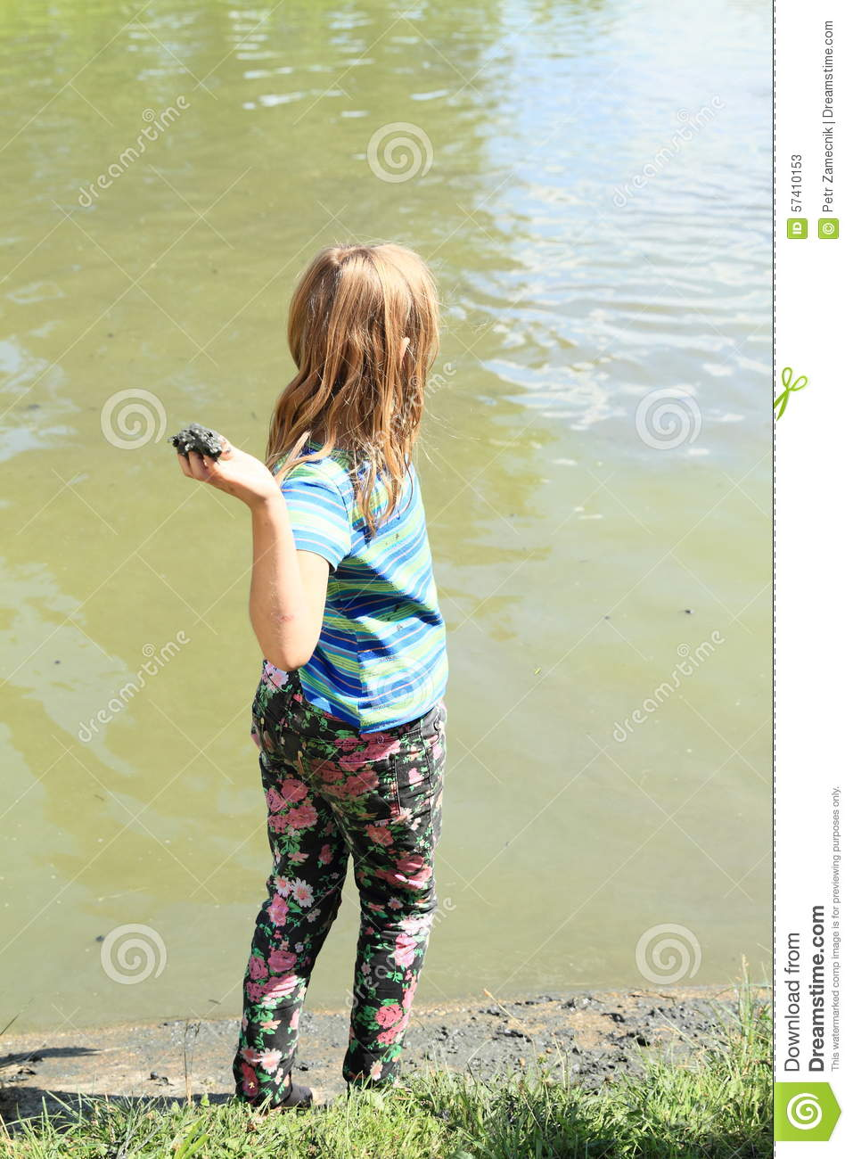 Girl Standing By Pond And Throwing Mud Stock Photo Image 57410153