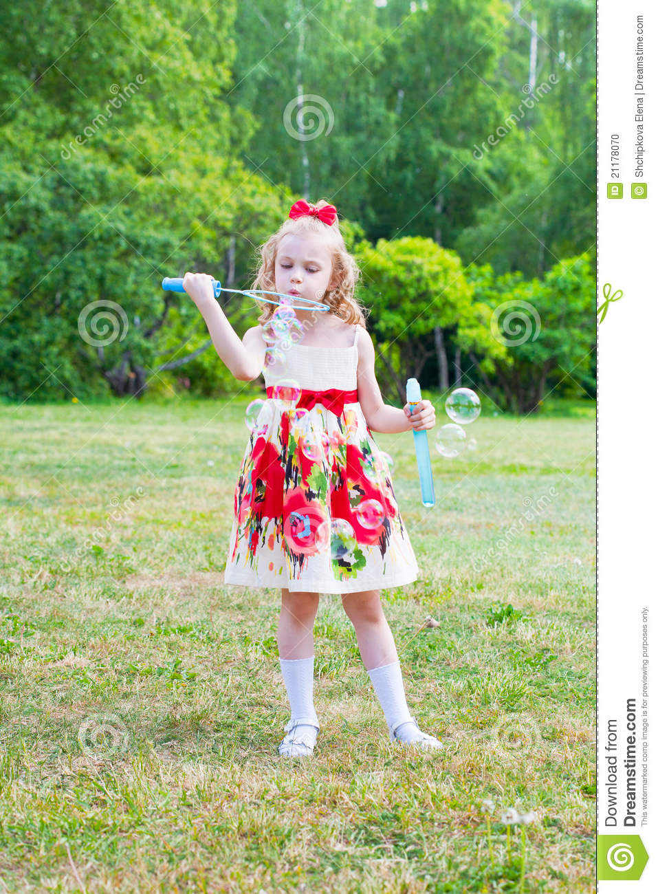 Girl starts up soap bubbles