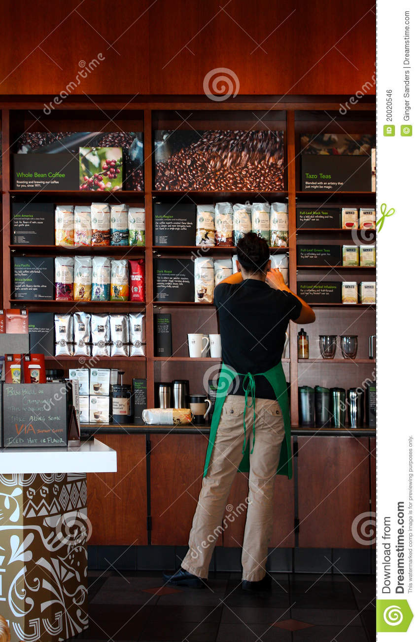 Girl Stocking Shelves in A Coffee Shop