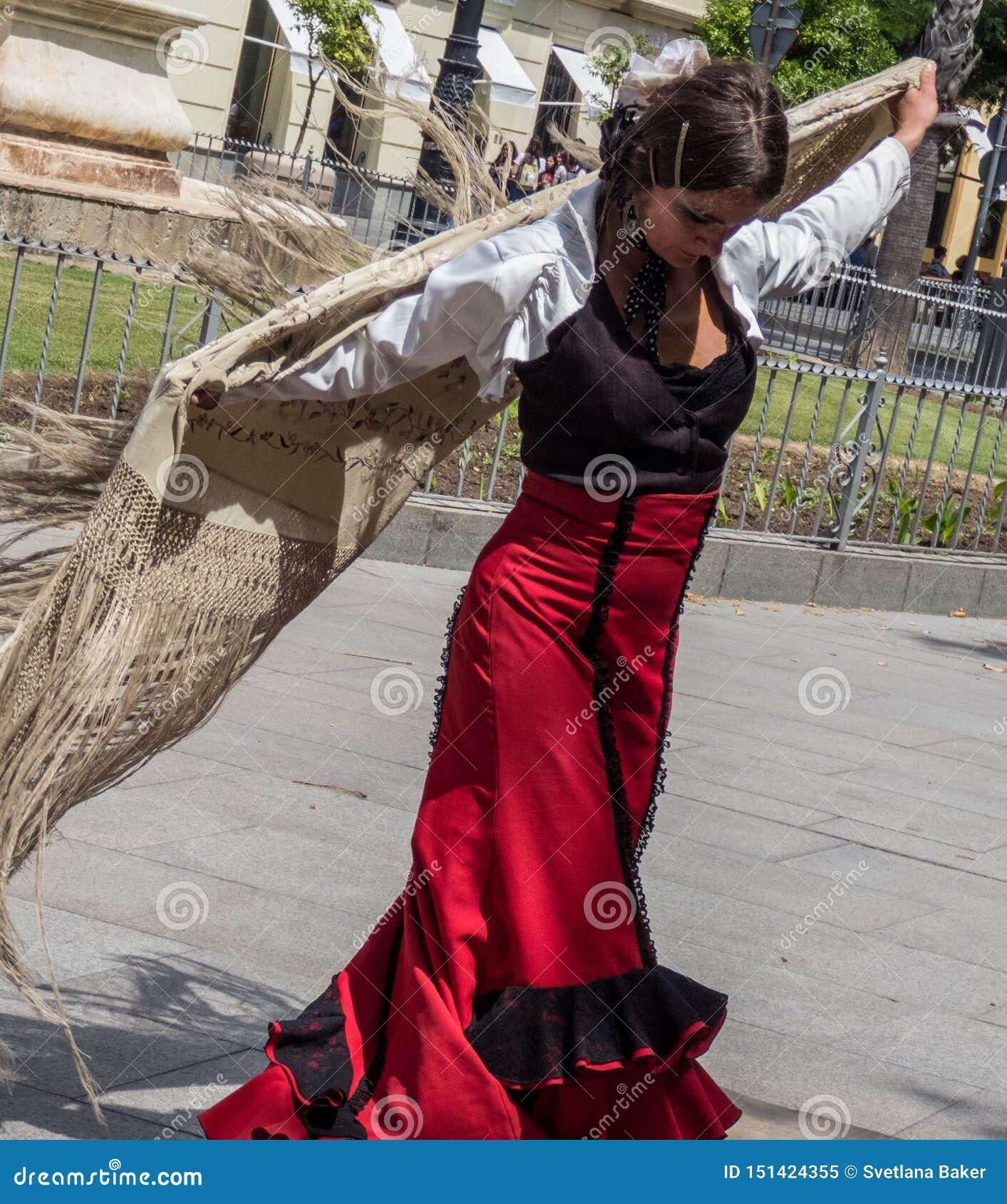 Sevilla, Andalusia, Spain, May 27 2019,girl on street dancing flamenco , flamenco dancer.