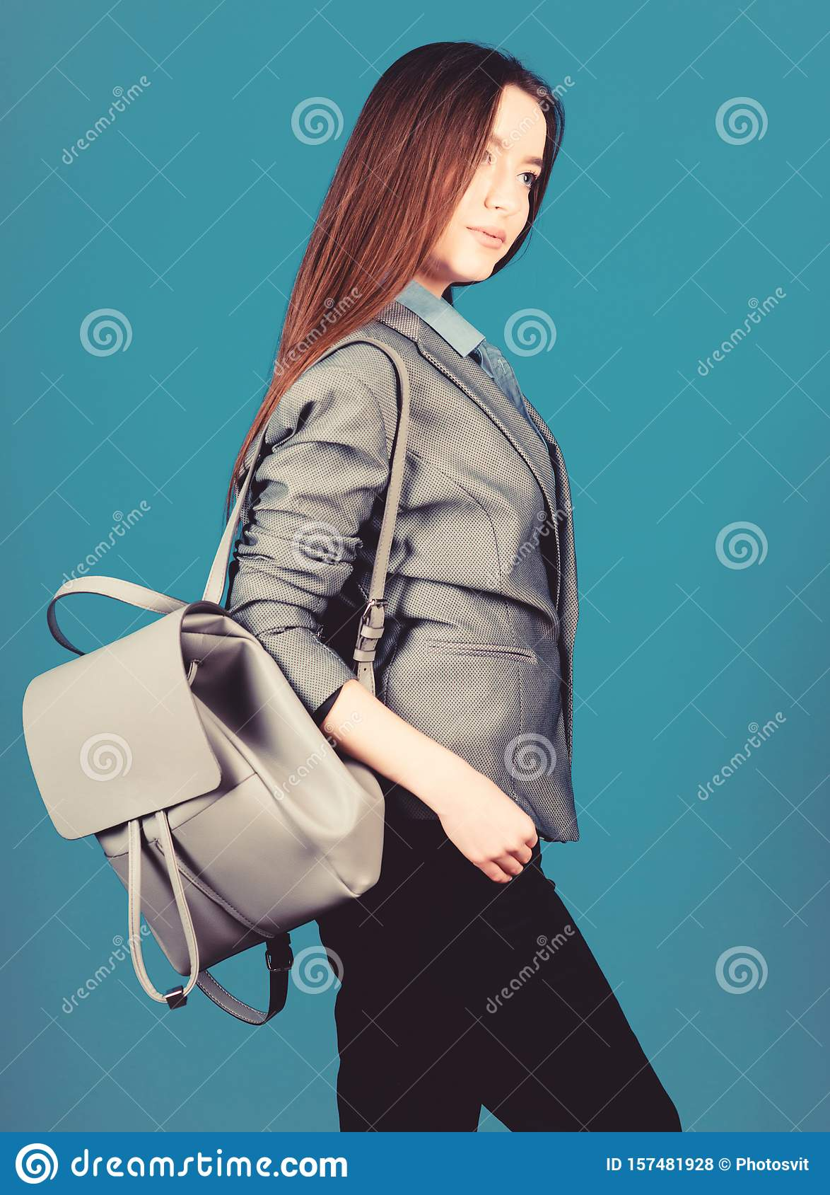 Girl student in formal clothes. Backpack fashion trend. Woman with leather knapsack. Stylish woman in jacket with