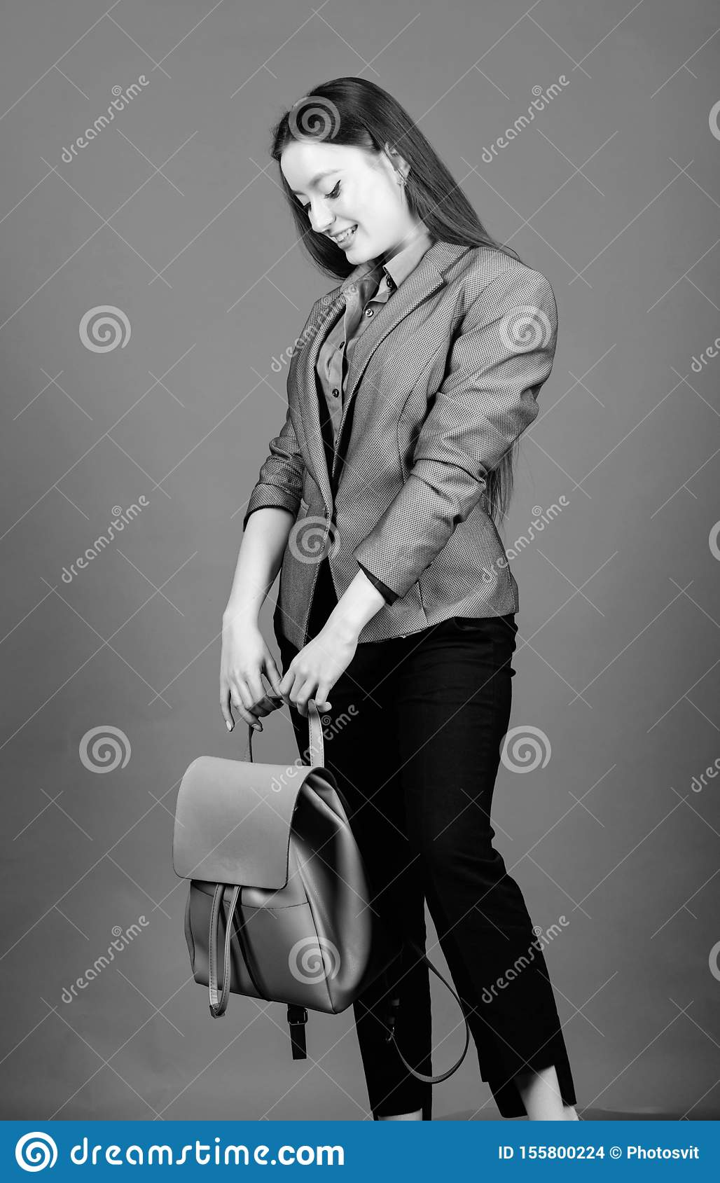 Girl student in formal clothes. female bag fashion. business. Shool girl with knapsack. student life. Smart beauty. Nerd